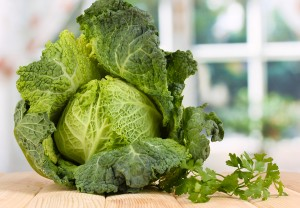 bigstock-Fresh-savoy-cabbage-on-wooden--38568460