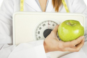 http://www.dreamstime.com/stock-photography-nutritionist-holding-green-apple-weight-scale-image28463742