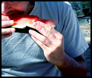 Man eating watermelon
