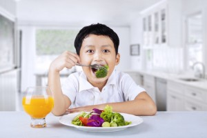 http://www.dreamstime.com/stock-photo-happy-boy-eating-salad-broccoli-inside-home-image30044420