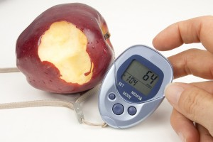 bigstock-Bitten-Apple-And-Pedometer-41281678