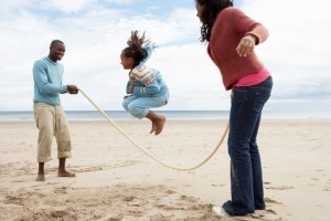 http://www.dreamstime.com/royalty-free-stock-photos-family-playing-beach-image19683878