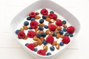 Yoghurt with fresh fruits and almonds