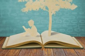 10734479 - paper cut of children read a book under tree