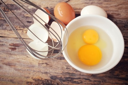42372485 - eggs in a bowl with whisk
