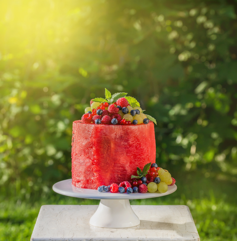watermelon cake with fresh summer berries, vegan raw food, square image, toned
